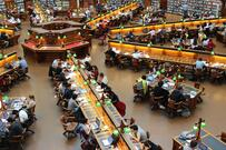 Scene of people studying and reading in a library.
